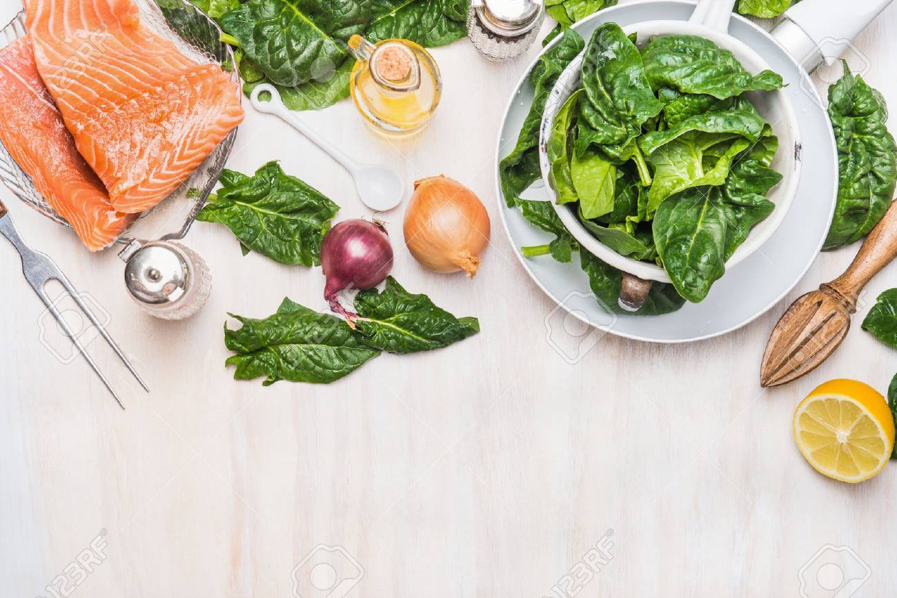 Spinach Leaves And Salmon Fillets With Ingredients On White