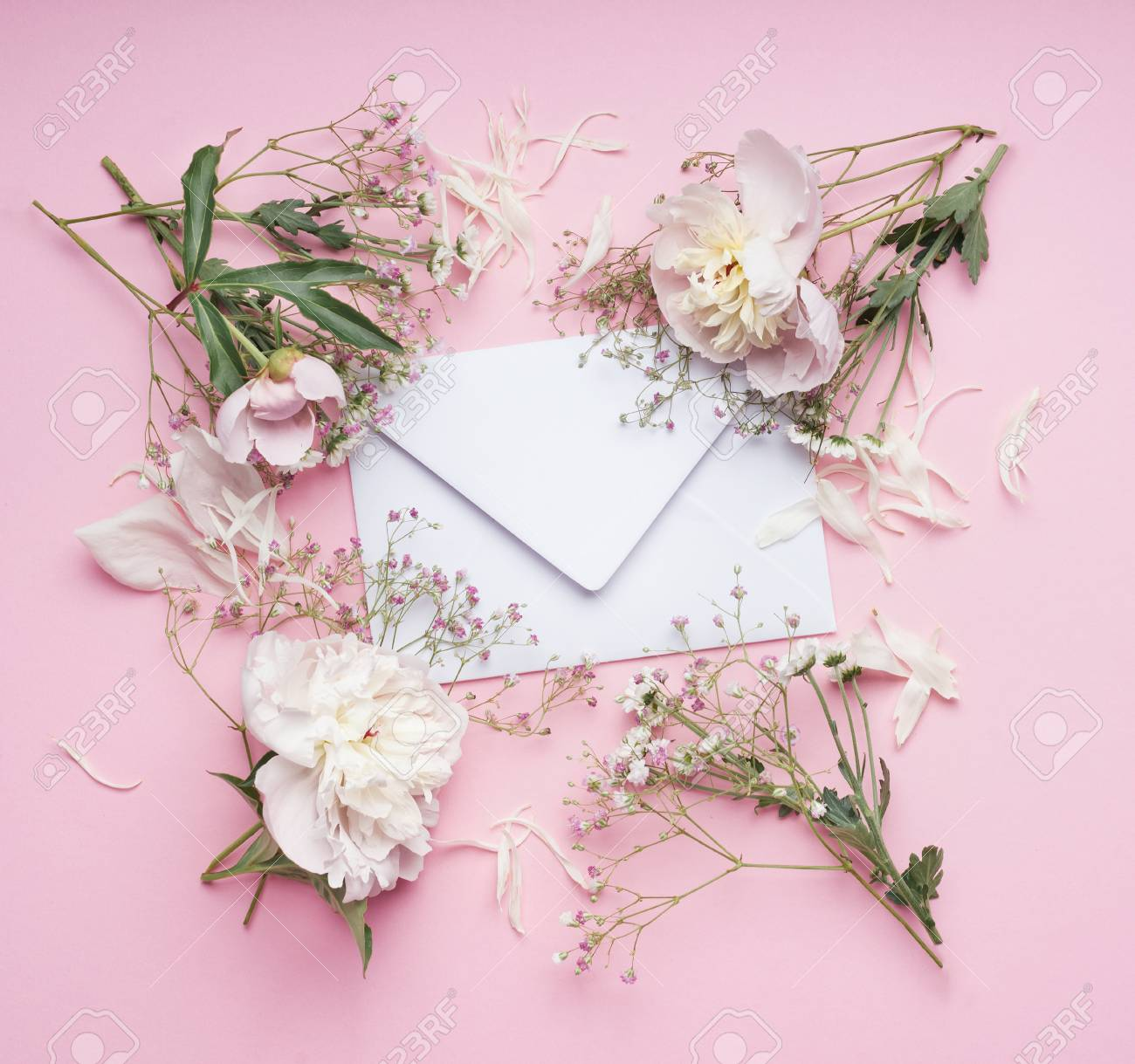 Pastel Pink Flowers Around White Envelop Floral Arrangement Stock Photo Picture And Royalty Free Image Image 80059540