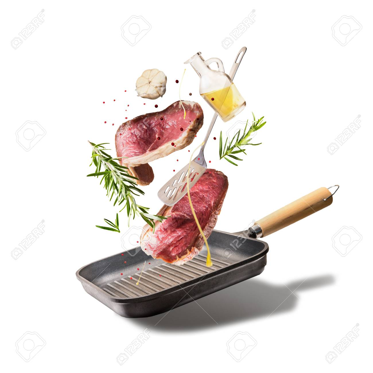 Flying Raw Beef Steaks With Herbs Oil And Spices With Grill