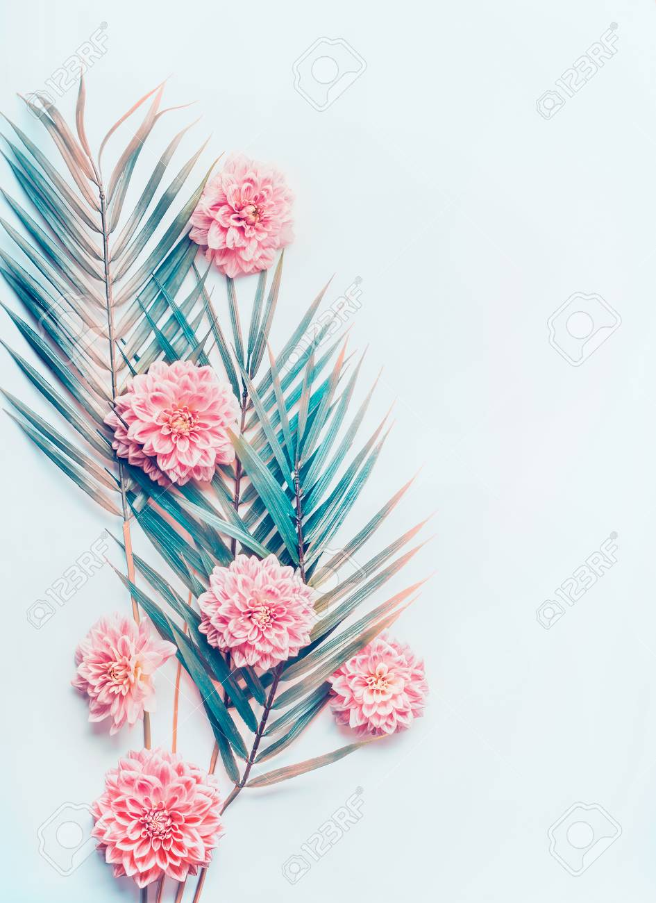 Creative Layout With Tropical Palm Leaves And Pastel Pink Flowers