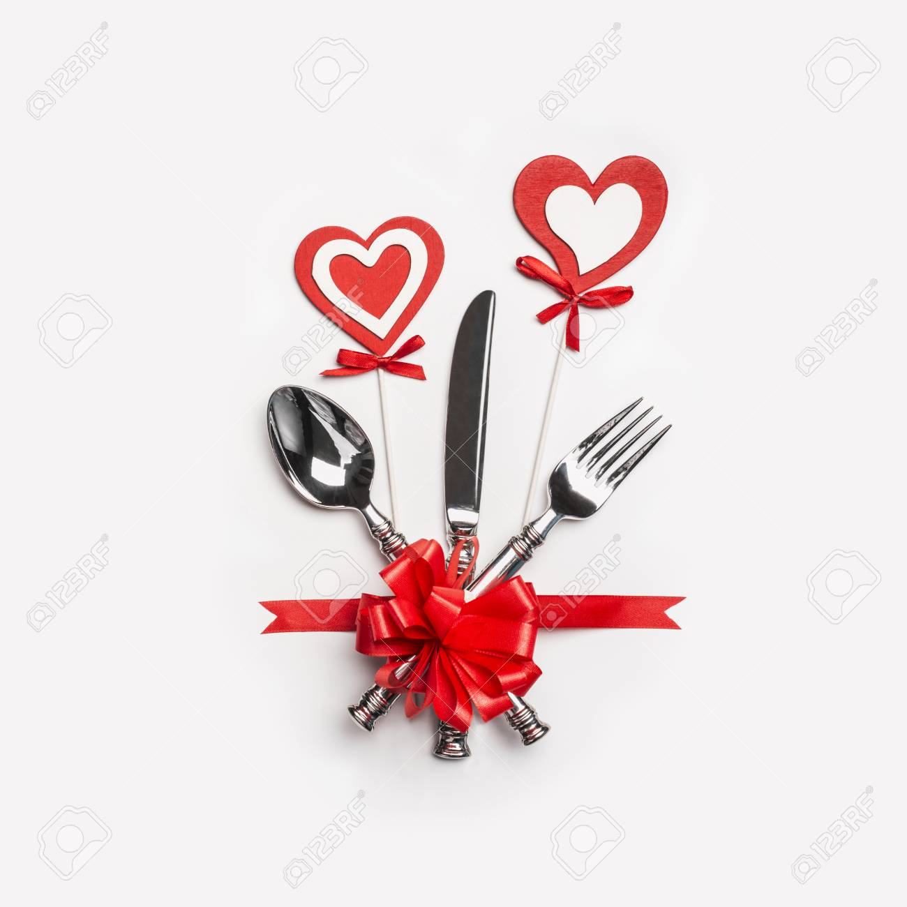 Stock Photo - Valentines day dinner table setting with cutlery red ribbon and hearts on white background top view & Valentines Day Dinner Table Setting With Cutlery Red Ribbon.. Stock ...