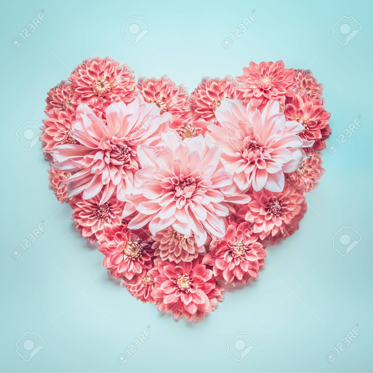 Pastel Color Heart Made Of Lovely Pink Flowers On Turquoise Blue