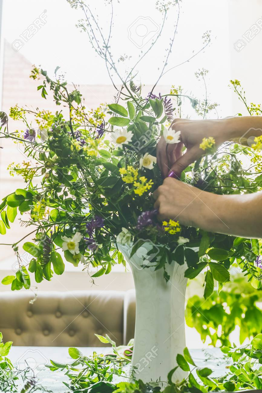 Female Hands Making Vase With Summer Bouquet Made From Field Stock Photo Picture And Royalty Free Image Image 104634393