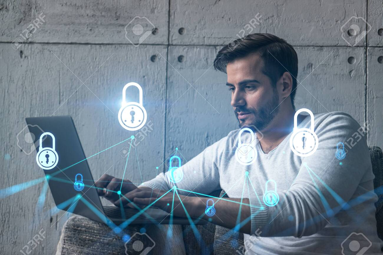 A serious caucasian programmer in casual wears, using laptop to develop a new security system to protect data. Double exposure. IT lock hologram icon. - 153794506