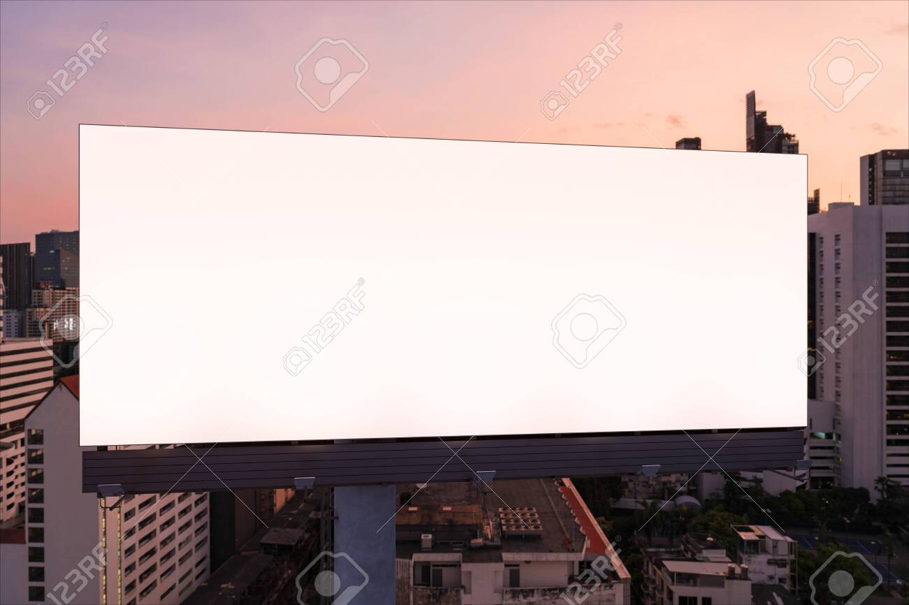 Blank white road billboard with Bangkok cityscape background at night time. Street advertising poster, mock up, 3D rendering. Front view. The concept of marketing communication to promote idea. - 154105960