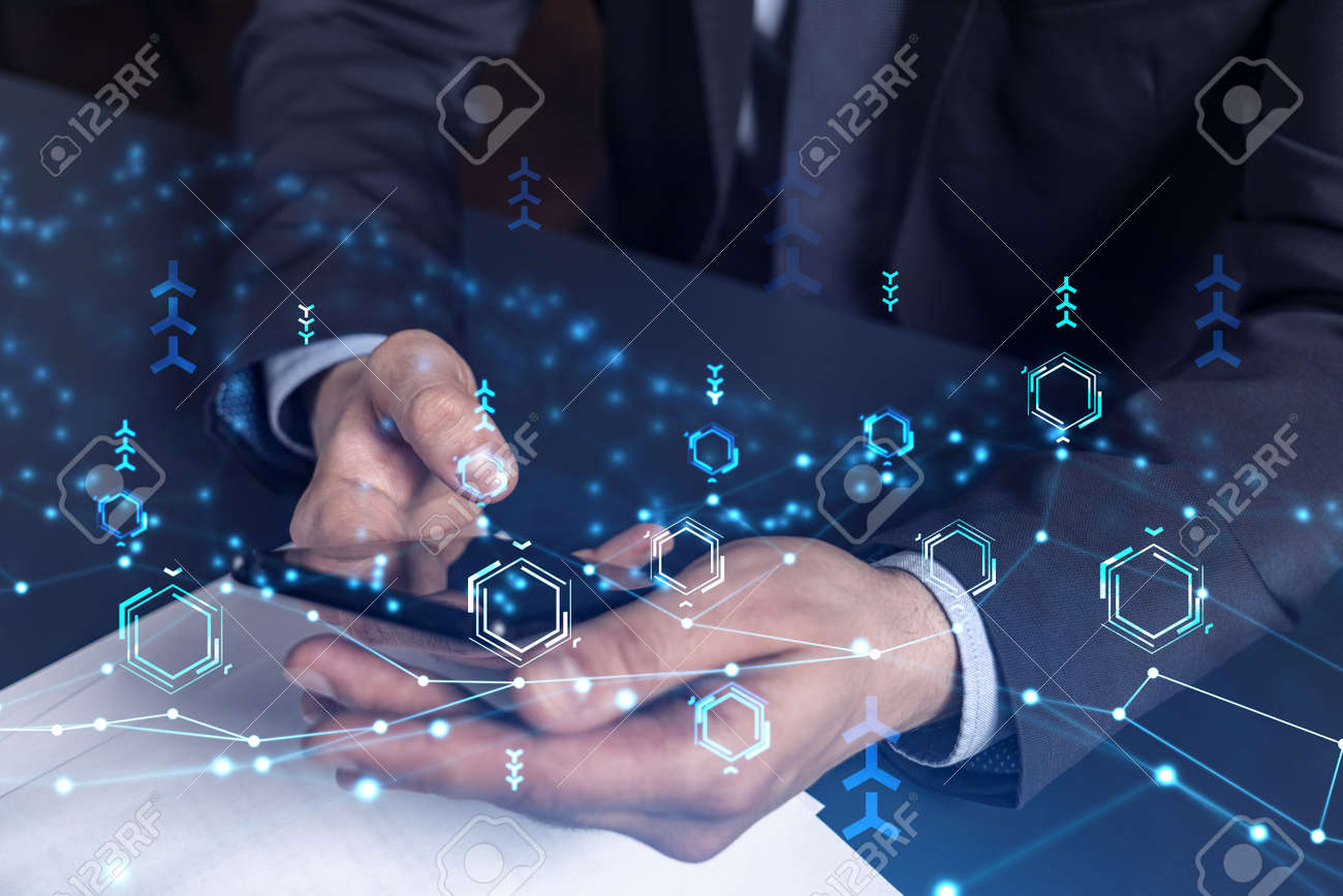 Programmer holding in the hands a smart phone and testing an innovative application to provide a completely new service. Close up shot. Hologram tech graphs. Concept of Dev team. Formal wear. - 168656176