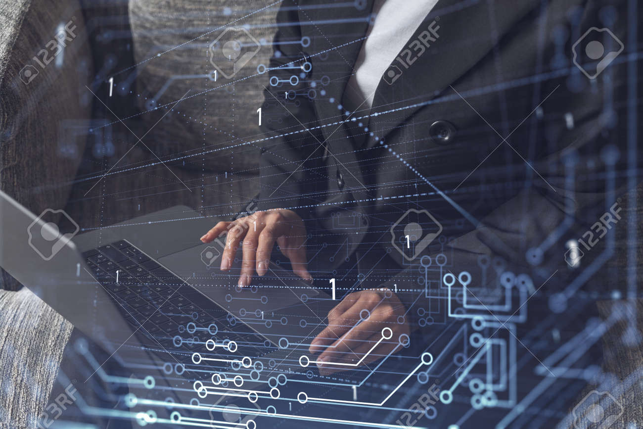Woman typing the keyboard to create innovative software to change the world and provide a completely new service. Close up shot. Hologram tech graphs. Concept of Dev team. Formal wear. - 168840156