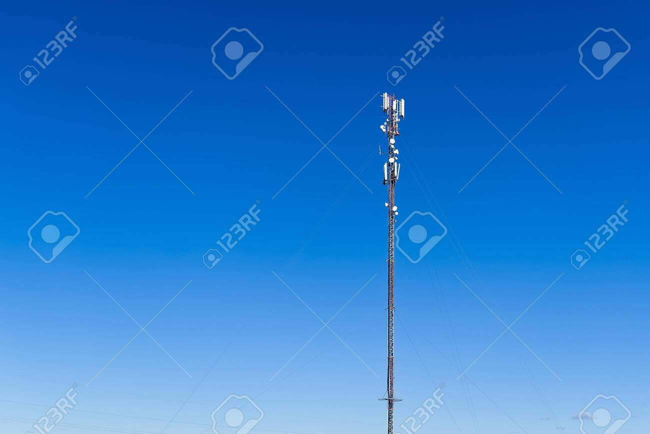 Telecommunication tower of 4G and 5G cellular. Cell Site Base Station. Wireless Communication Antenna Transmitter. Telecommunication tower with antennas against blue sky background. - 149004910