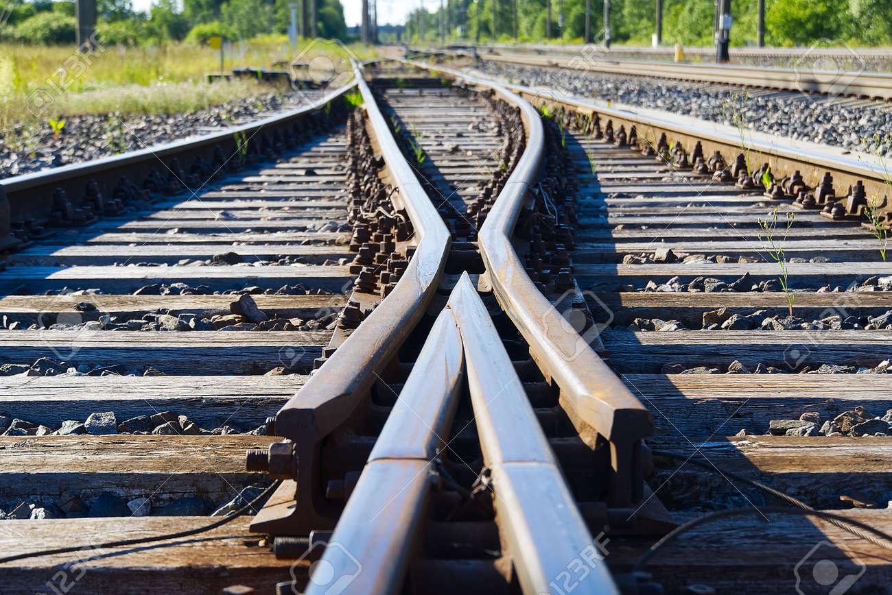 Railroad closeup. Railway tracks, Iron rusty train railway detail over dark stones. - 149920004