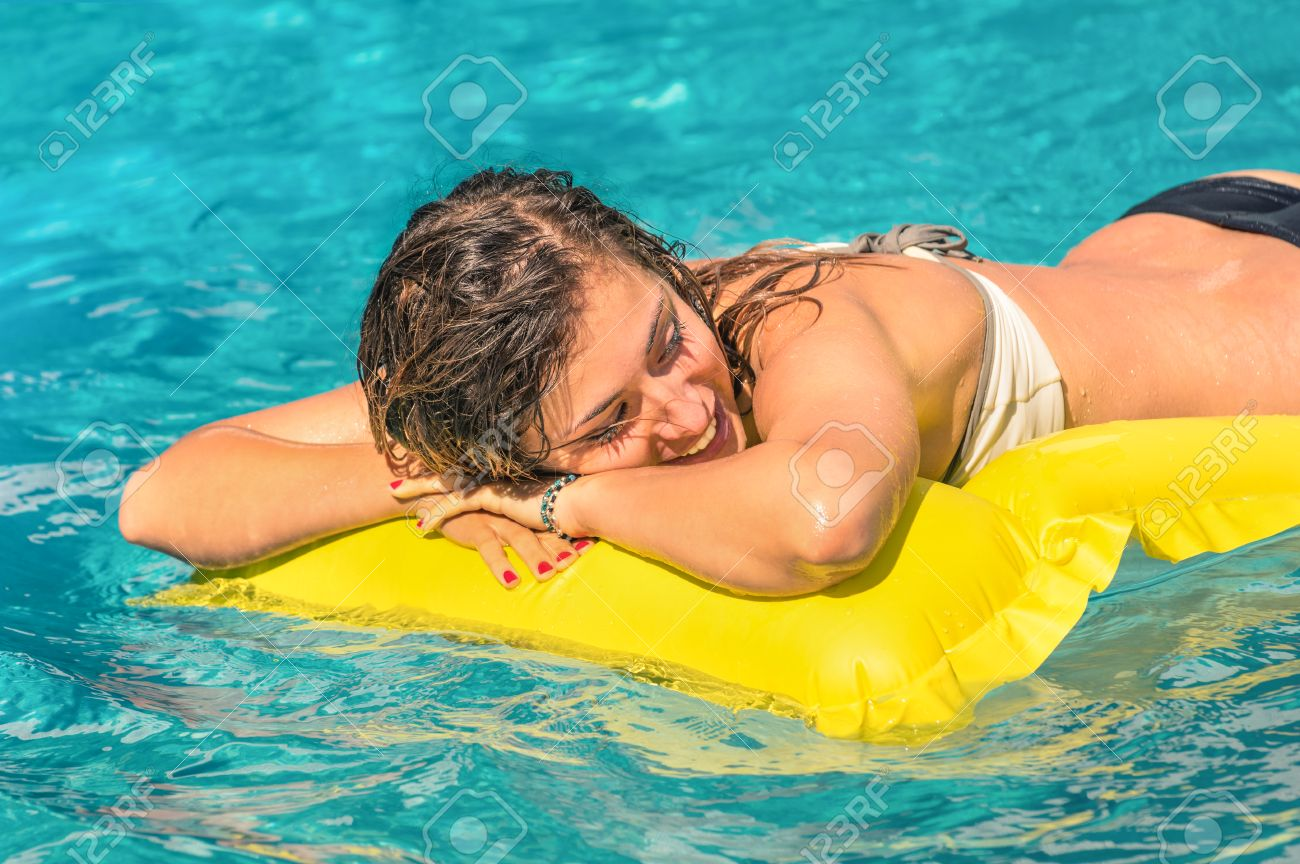 Inflatable bed clear - Beautiful Young Woman Relaxing On A Yellow Inflatable Mattress In Clear Blue Water Summer Chilling