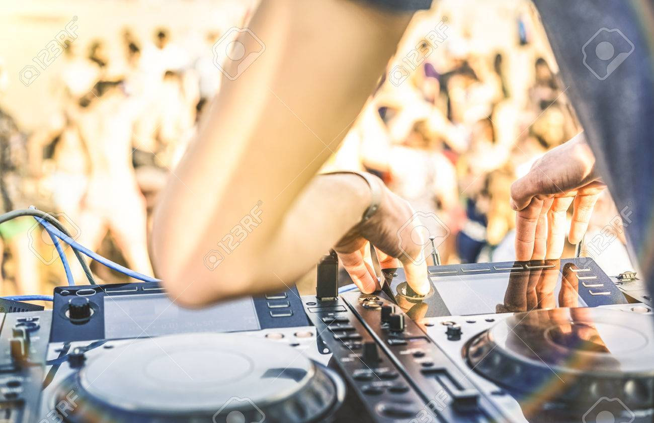 Close up of dj playing electro sound on modern cd usb player at summer beach party - Music festival and entertainment concept - Defocused background with shallow depth of field - Focus on mixing hand - 78679168
