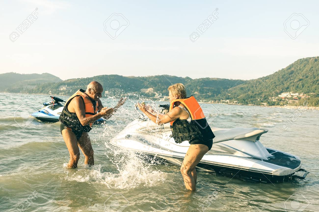 Senior Happy Couple Having Playful Fun At Jet Ski On Beach Island Stock Photo Picture And Royalty Free Image Image 91052921