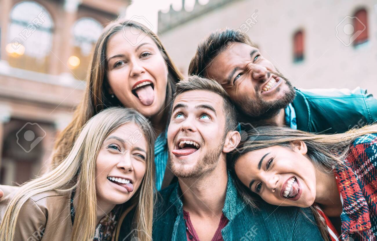 Best friends taking selfie at city tour trip - Happy friendship concept with millennial people having fun together - Everyday life concept of new generation representatives enjoying carefree lifestyle - 134676928