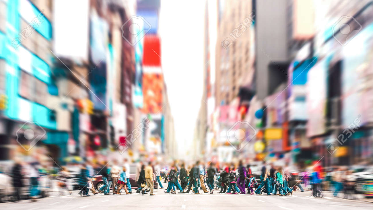 Defocused background of people walking on zebra crossing on 7th avenue in Manhattan - Crowded streets of New York City during rush hour in urban area - Vivid sunset filter with soft sharp focus - 165190131