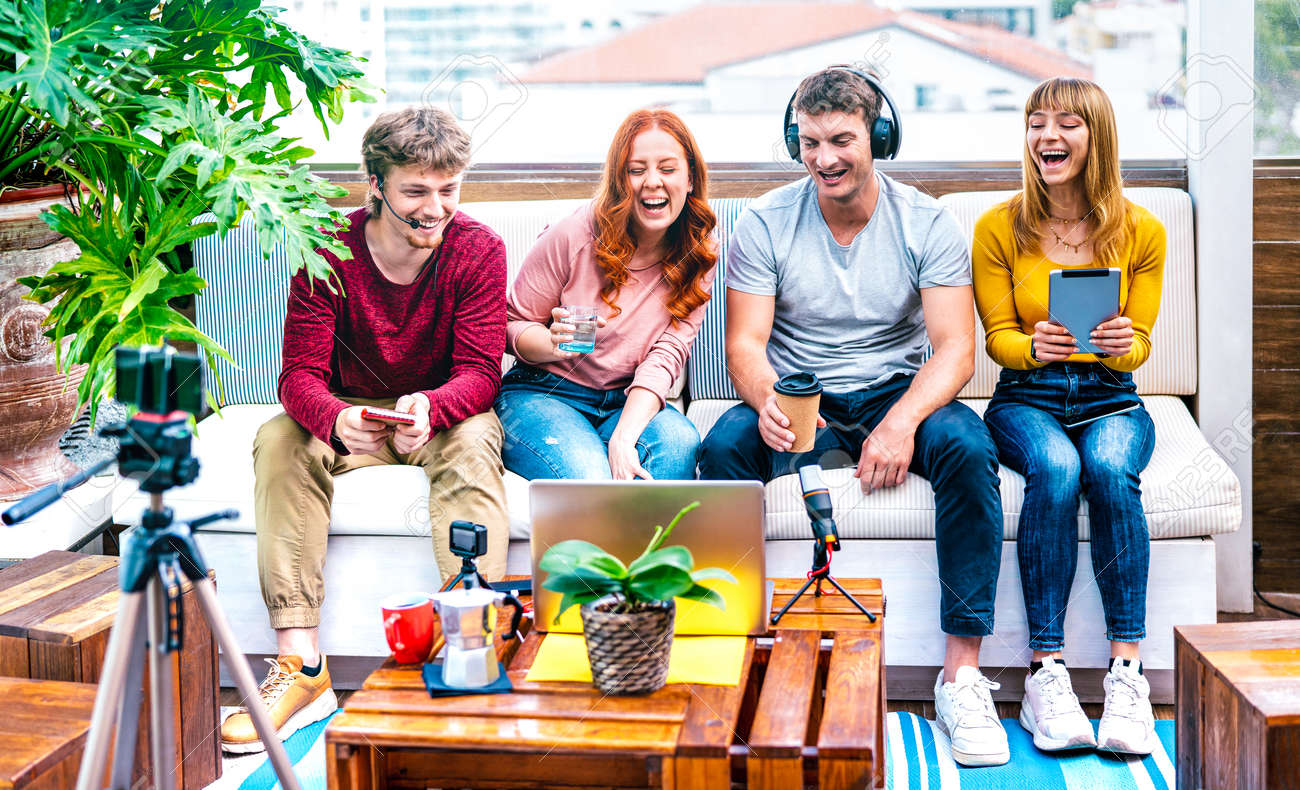 Young people startupper having fun on streaming platform with web cam - Start up marketing concept with millennial guys and girls sharing live vlog feed on social media network - 169667500