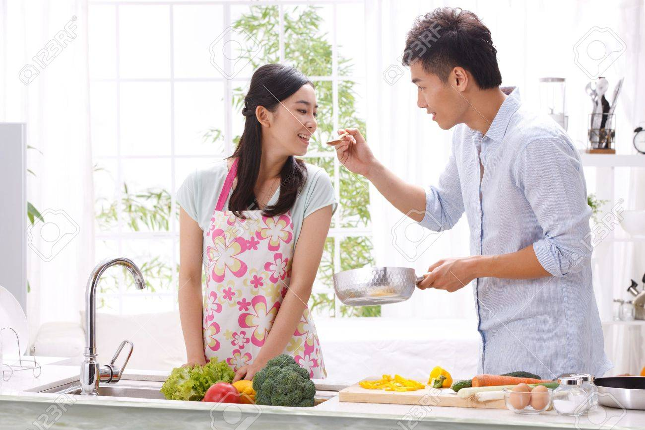 Young couple in kitchen Stock Photo - 16191150