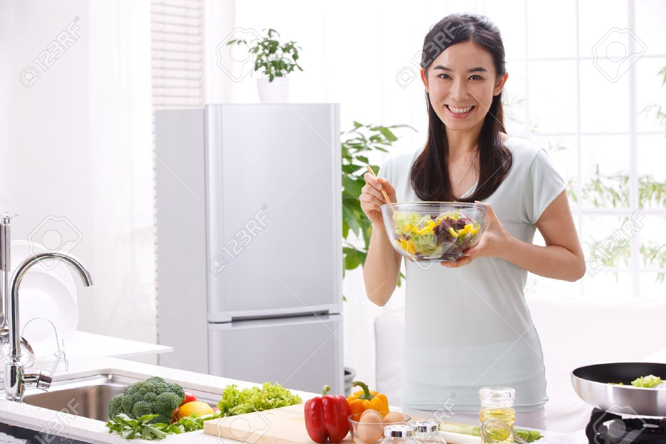 young woman in kitchen stock photo picture and royalty free image