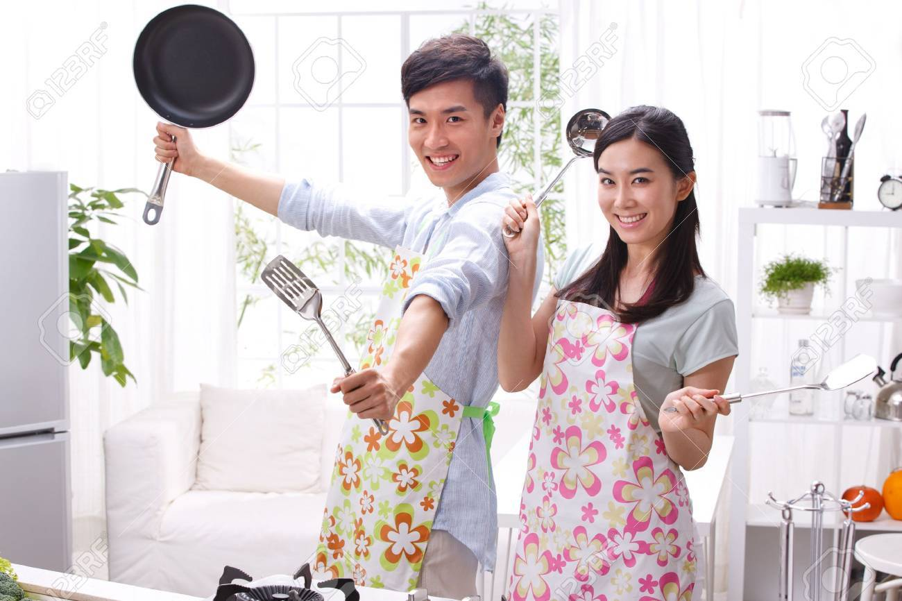 Young couple in kitchen Stock Photo - 16191145