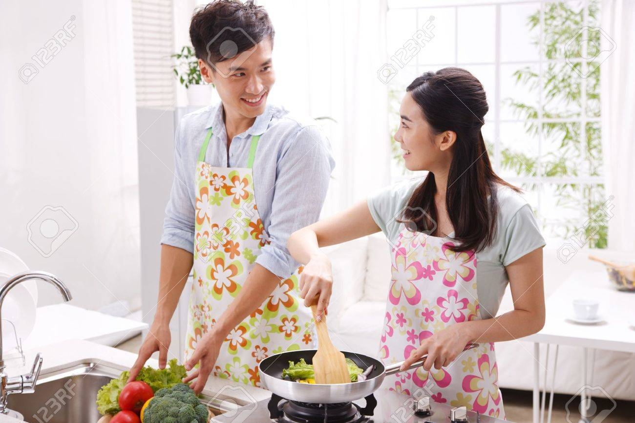 Young couple in kitchen Stock Photo - 16191141