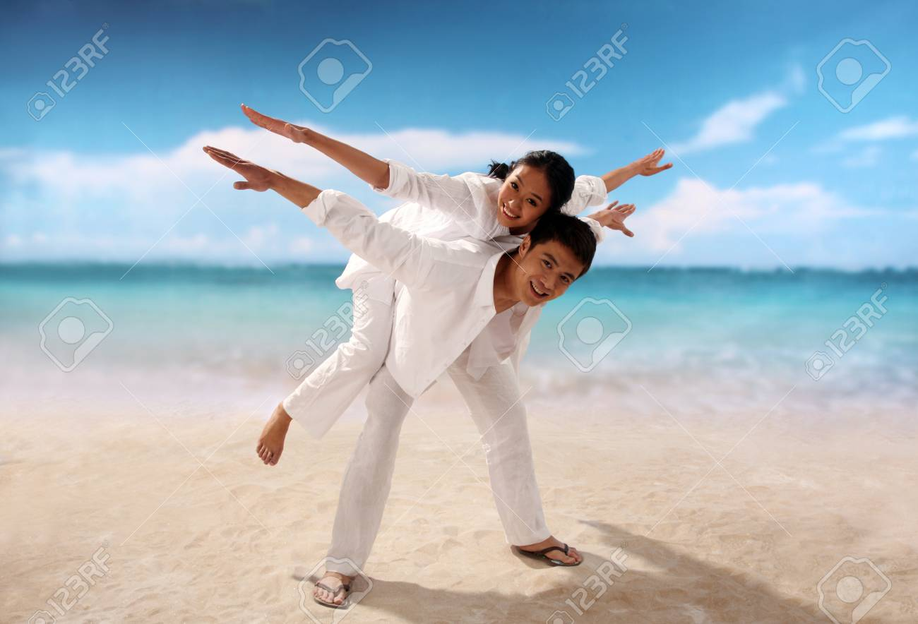 Playful couple at the beach Stock Photo - 22752477
