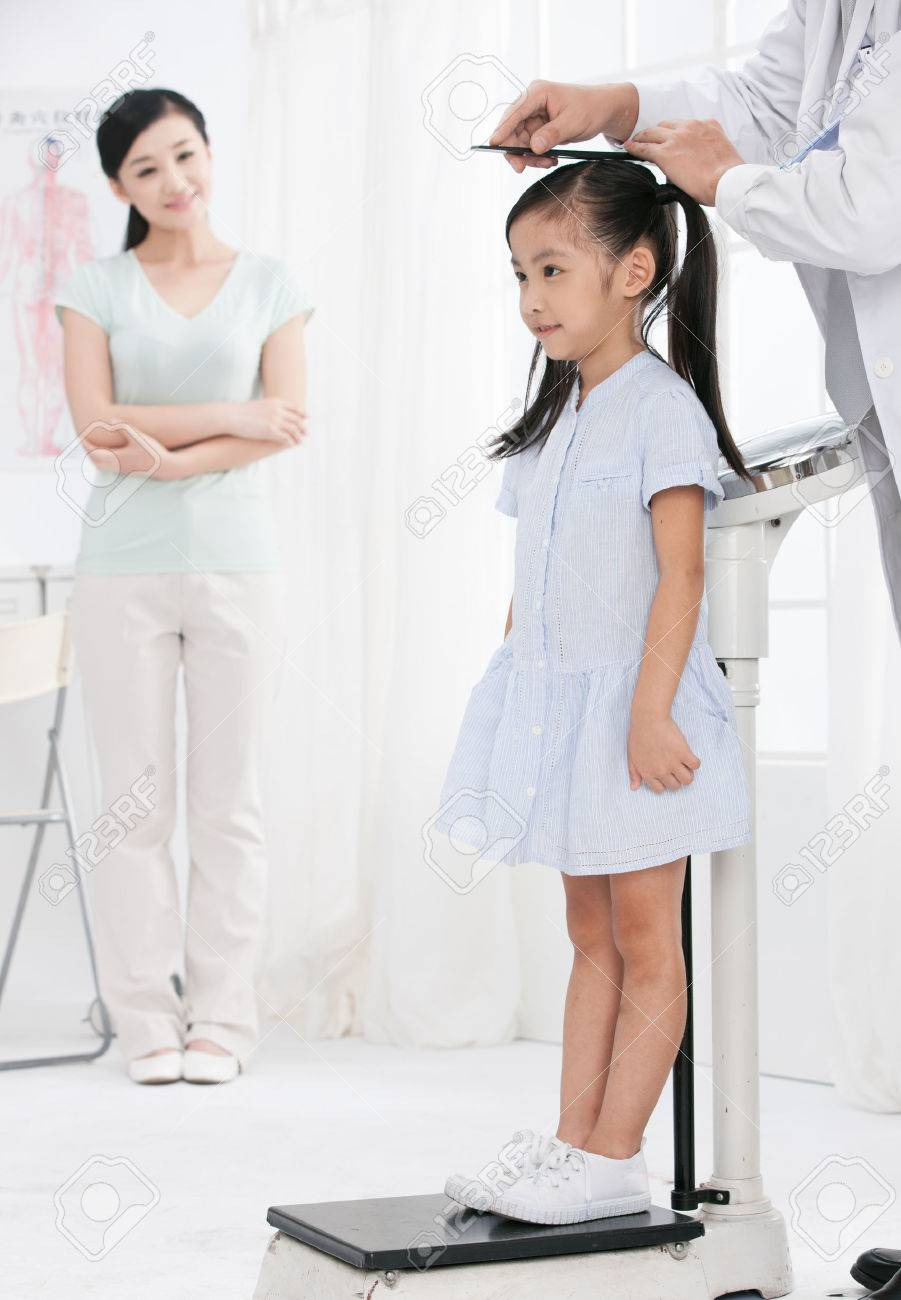 doctor and girl with her mother Stock Photo - 30133182