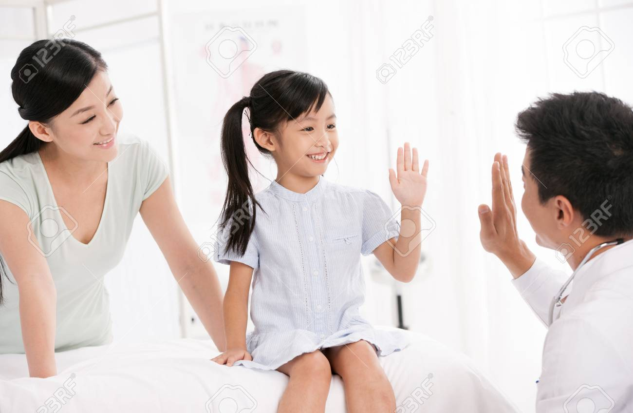 doctor and girl with her mother Stock Photo - 30133191