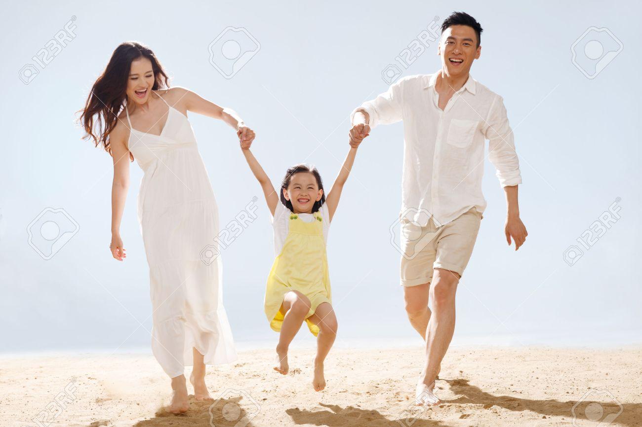 Family on beach Stock Photo - 34917173