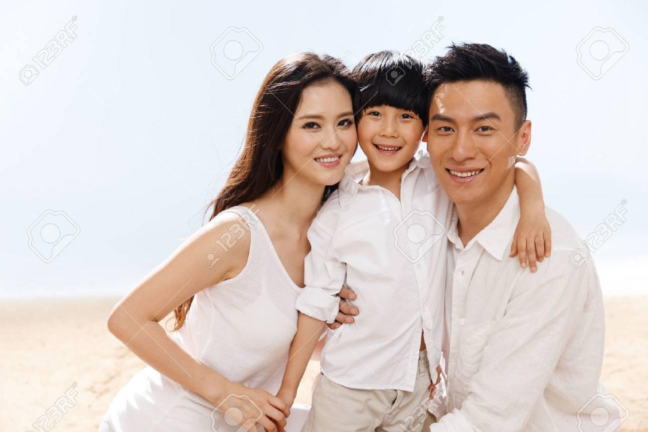 Family on beach Stock Photo - 34917182