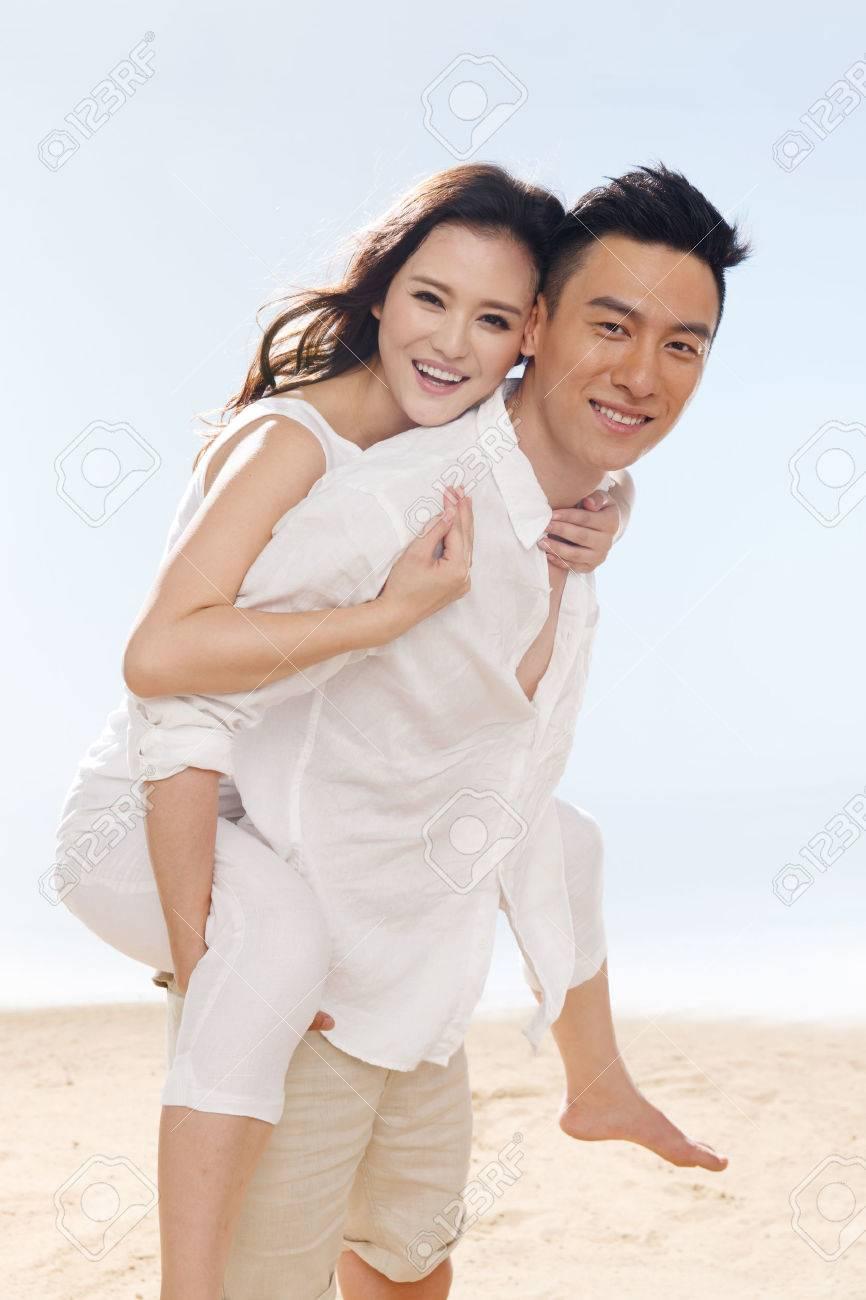 Couple on beach Stock Photo - 34917189
