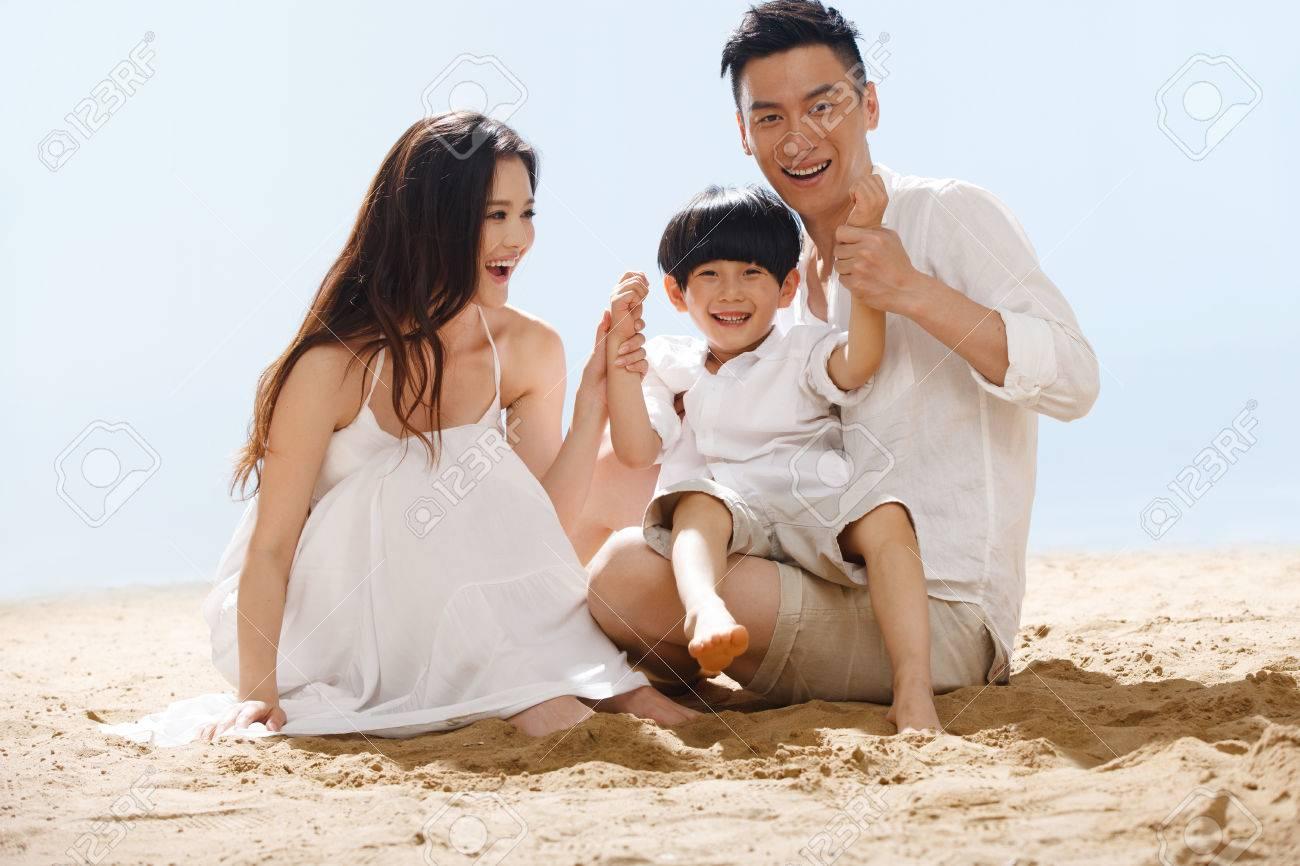 Family on beach Stock Photo - 34917192