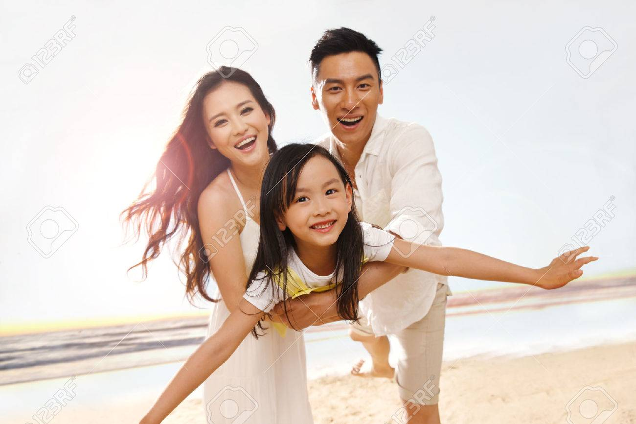 Family on beach Stock Photo - 34917199