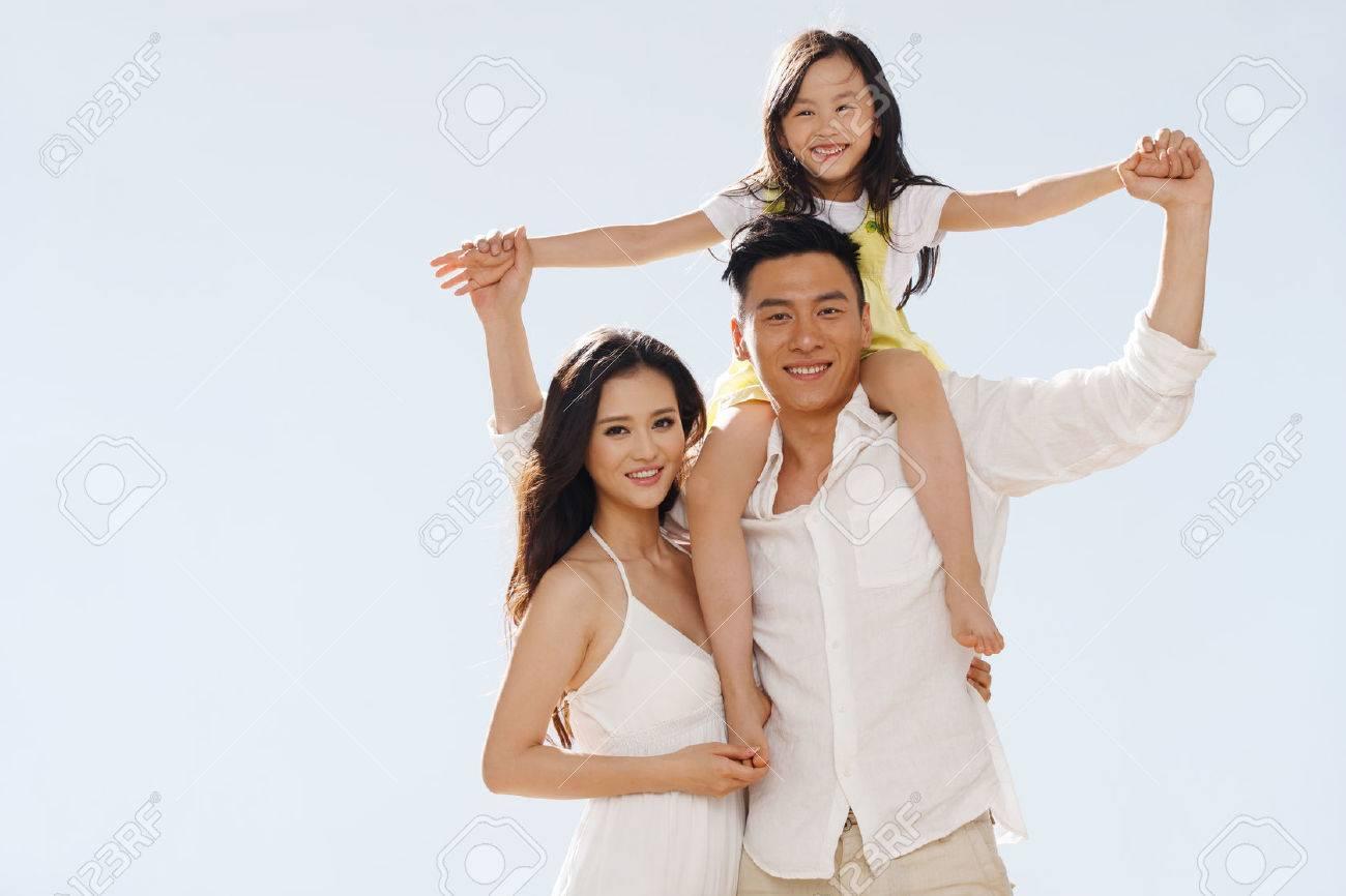 Family on beach - 34917204