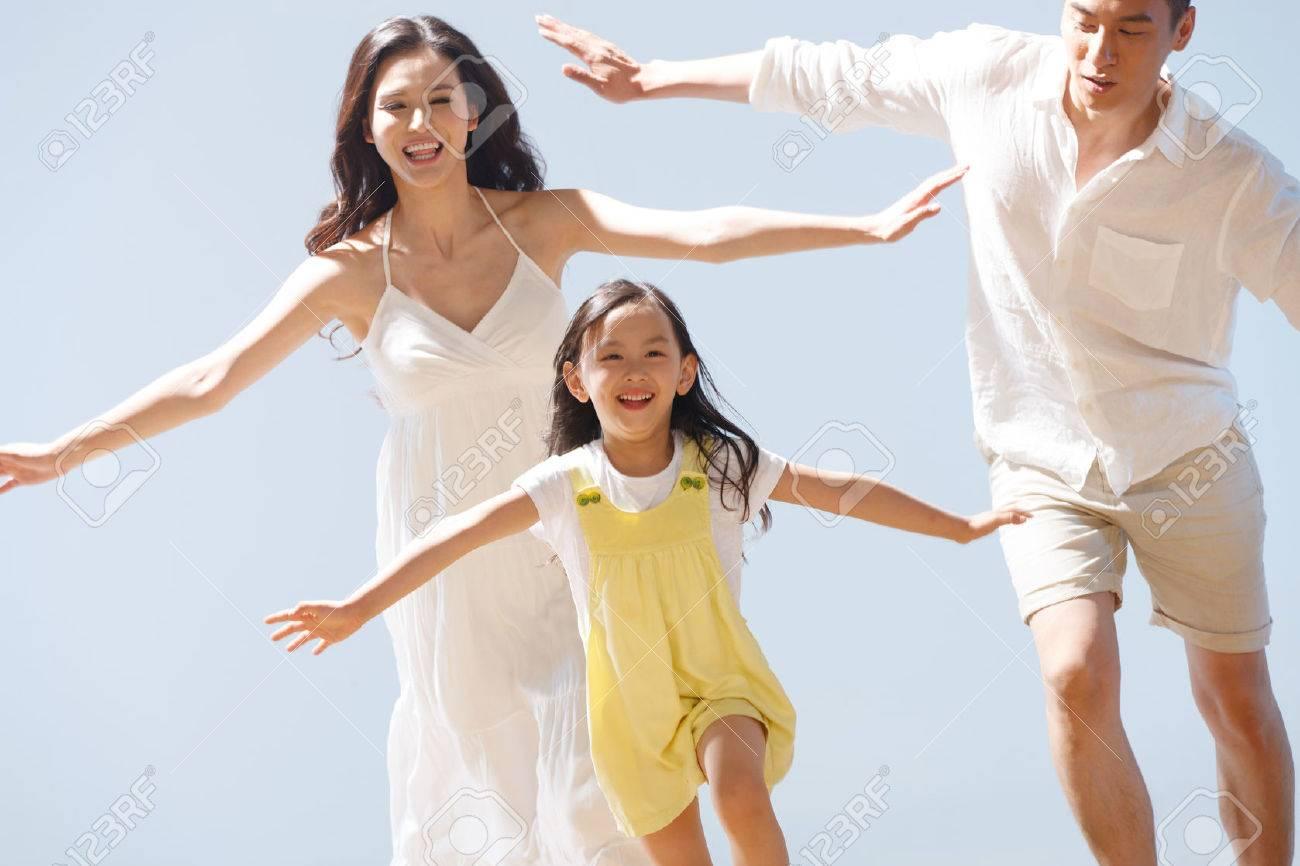 Family on beach - 34917211