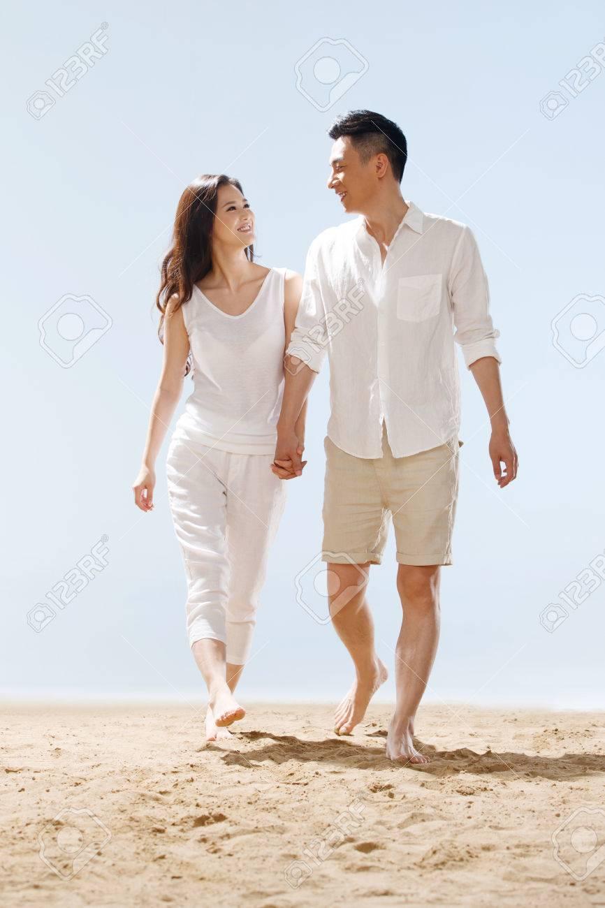 Couple on beach - 34917212