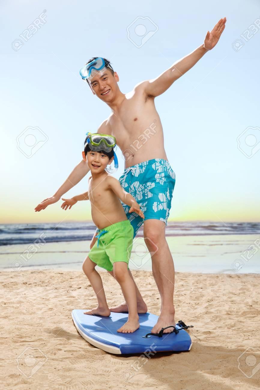 Family on beach Stock Photo - 34917224