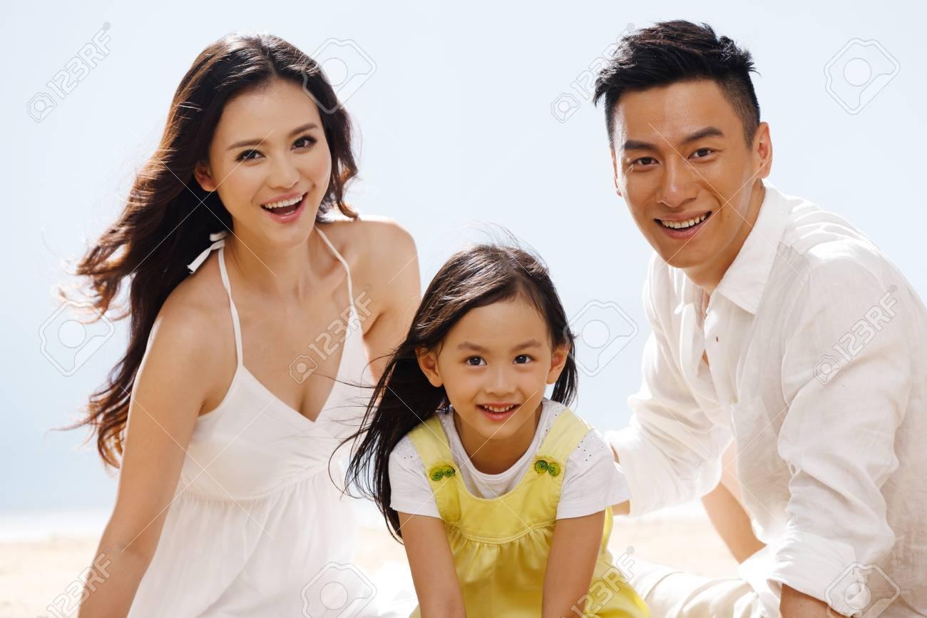Family on beach - 34917225