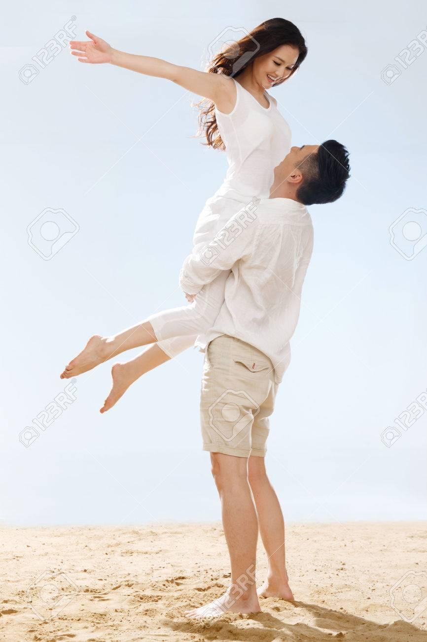 Couple on beach - 34917226