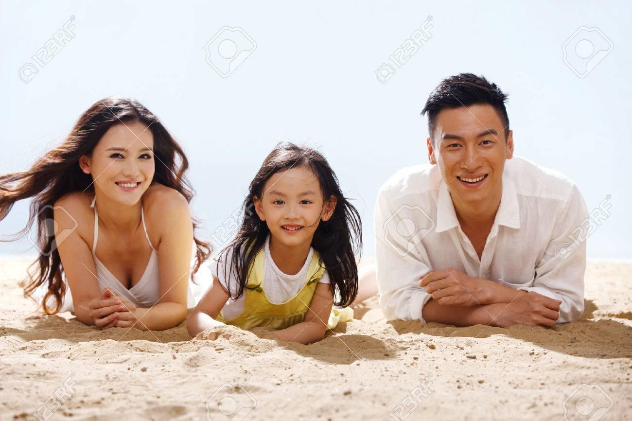 Family on beach Stock Photo - 34917227