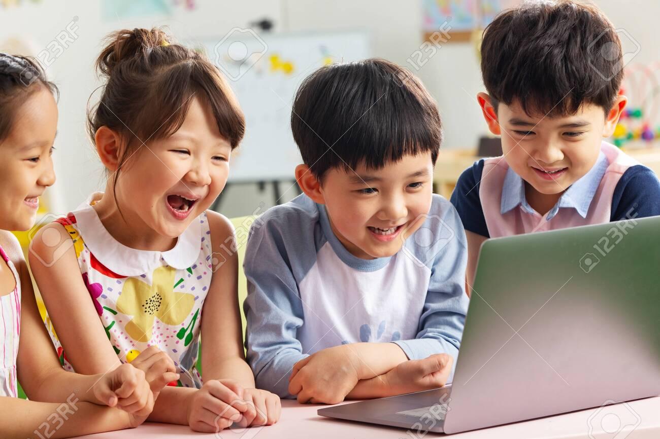 The kindergarten children watch video - 137635196