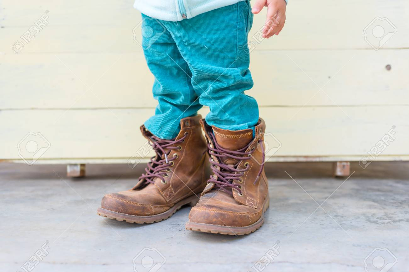 41a89f791 Thai Baby Boy Try To Wearing Father's Boots Stock Photo, Picture And ...