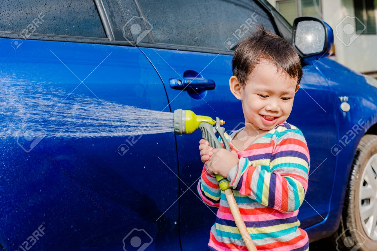 Asian Baby Boy Washing Blue Car By Green Water Sprayer Stock Photo ...