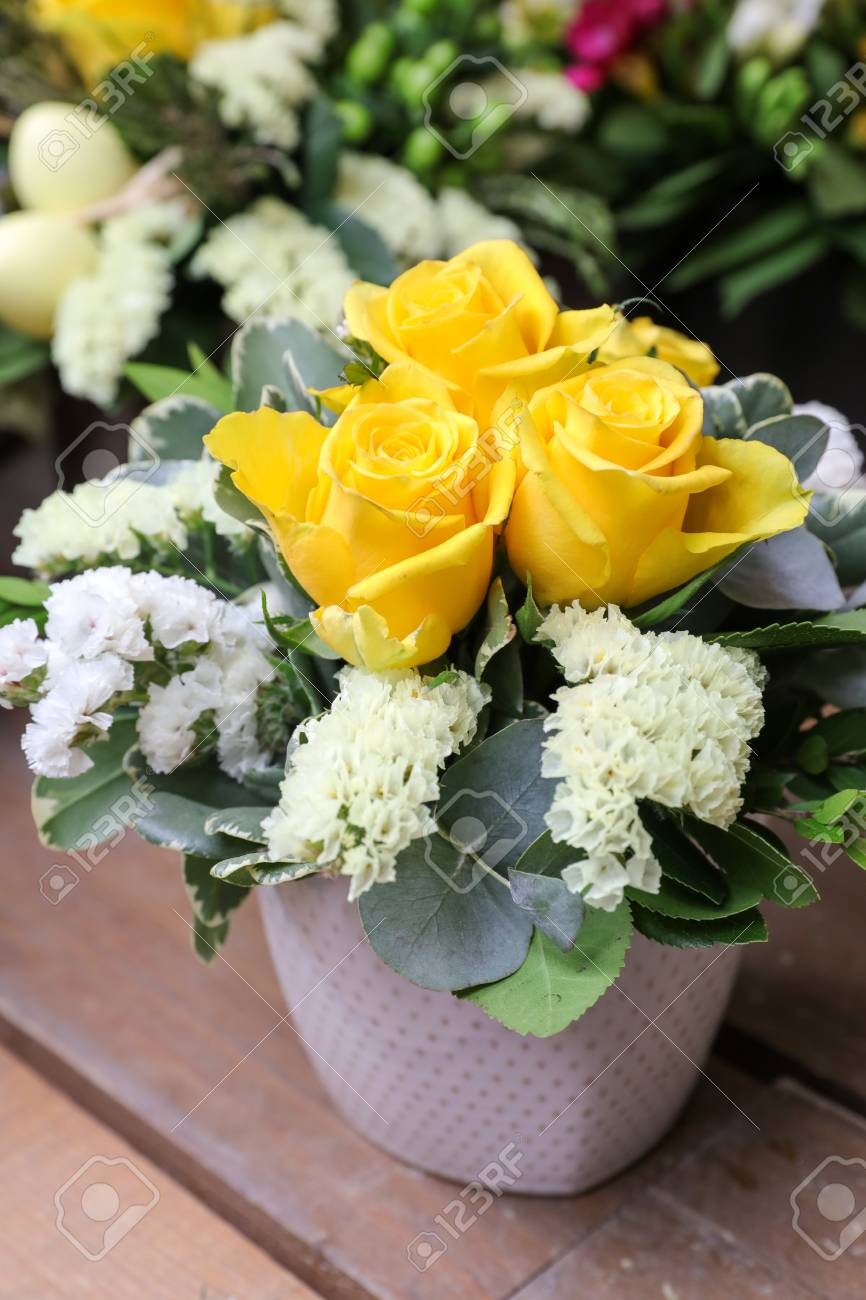 A Beautiful Bouquet Of Yellow Roses And White Kermek Flowers Stock