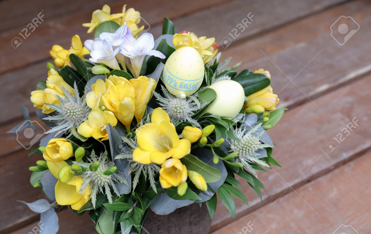 Festive Flower Arrangement Of Yellow And White Freesia Flowers