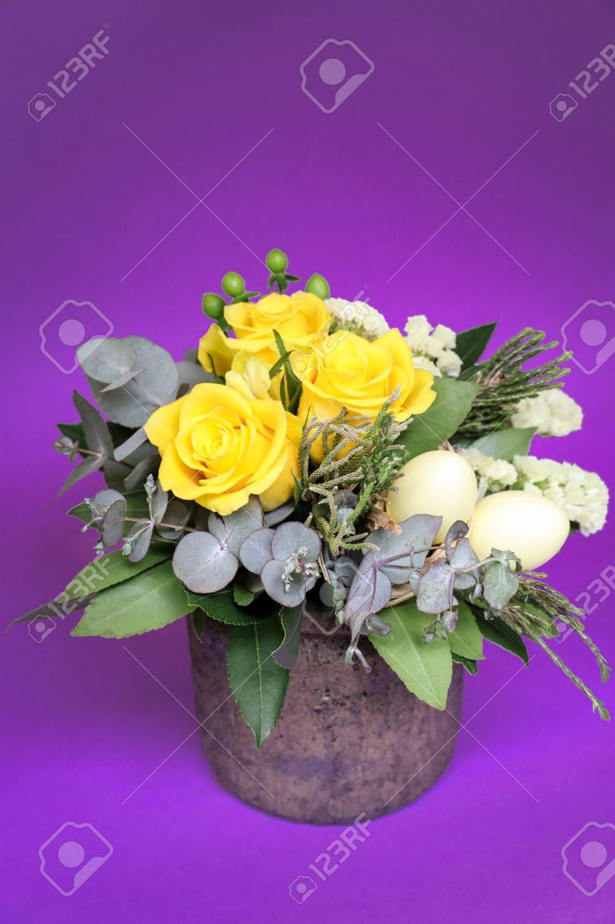Festive Flower Arrangement Of Yellow Roses And Other Plants With