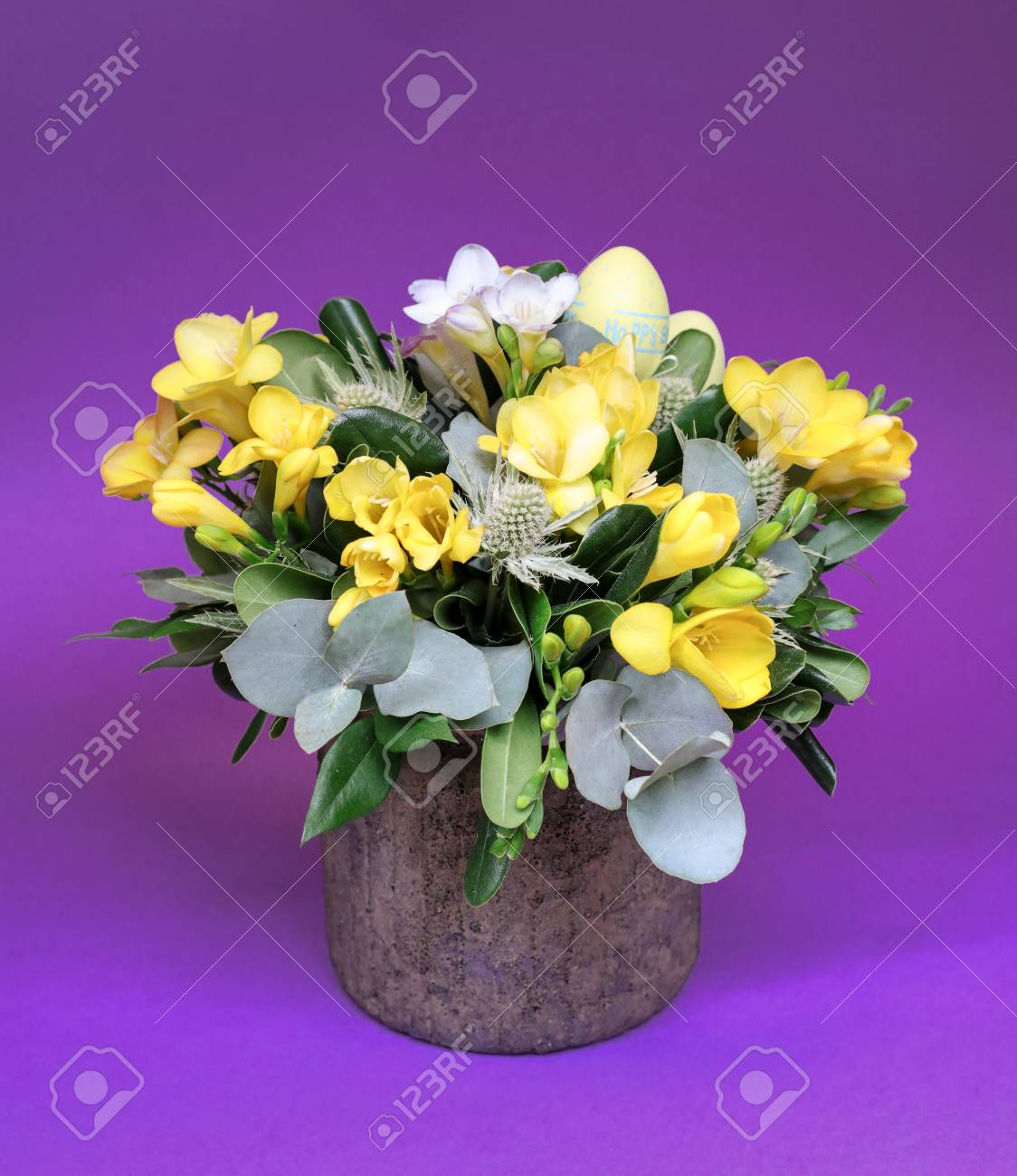 Festive flower arrangement of yellow and white freesia flowers festive flower arrangement of yellow and white freesia flowers and other plants with easter eggs decorated izmirmasajfo