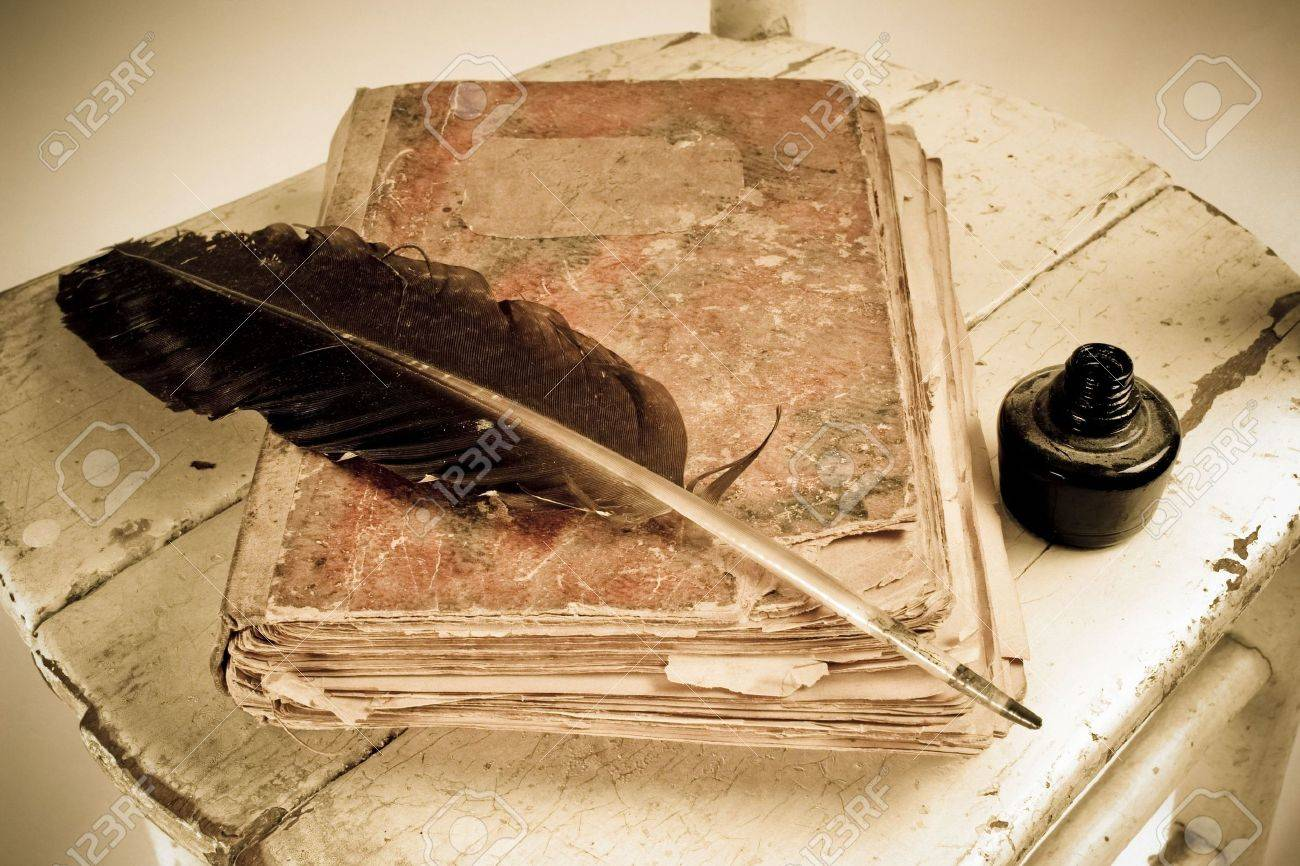 Old book, quill and black ink Stock Photo - 2754067