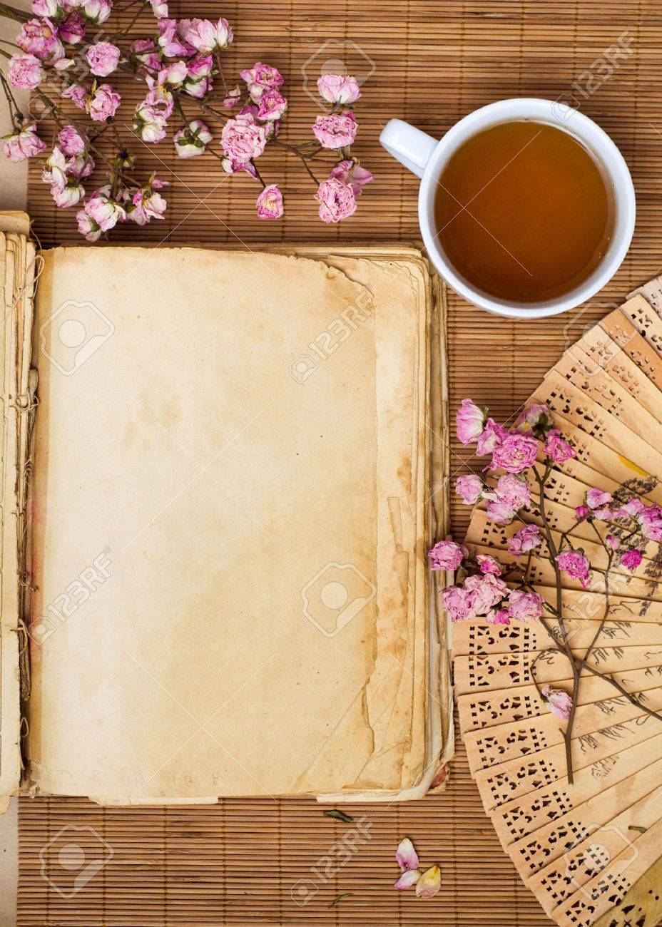 Green tea and old book Stock Photo - 6174925