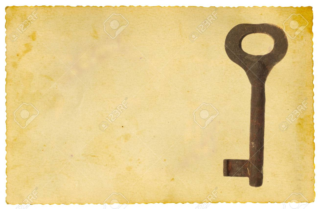 Old key on vintage paper. Isolated on white. Stock Photo - 6831743