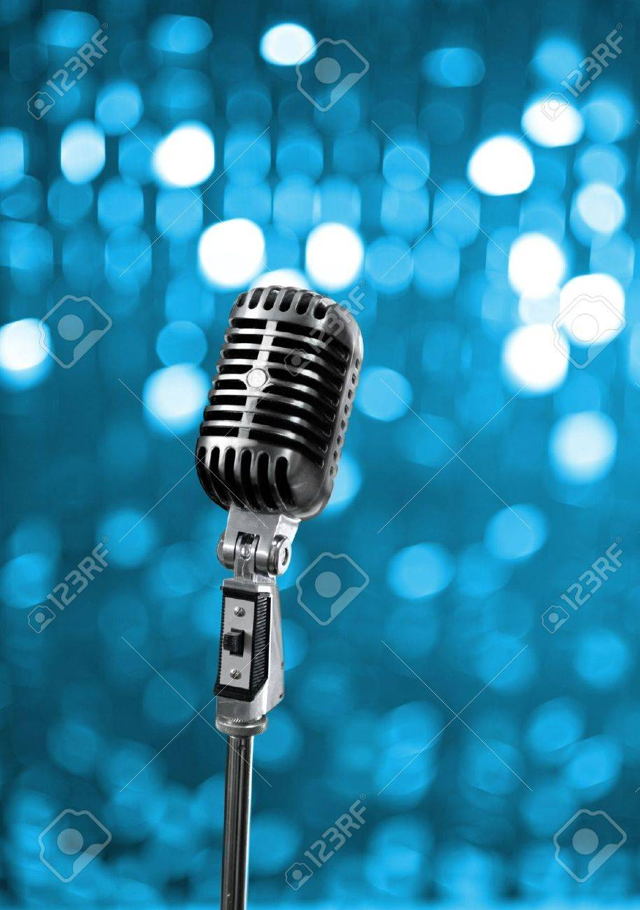 Retro microphone on blue stage - 7577100