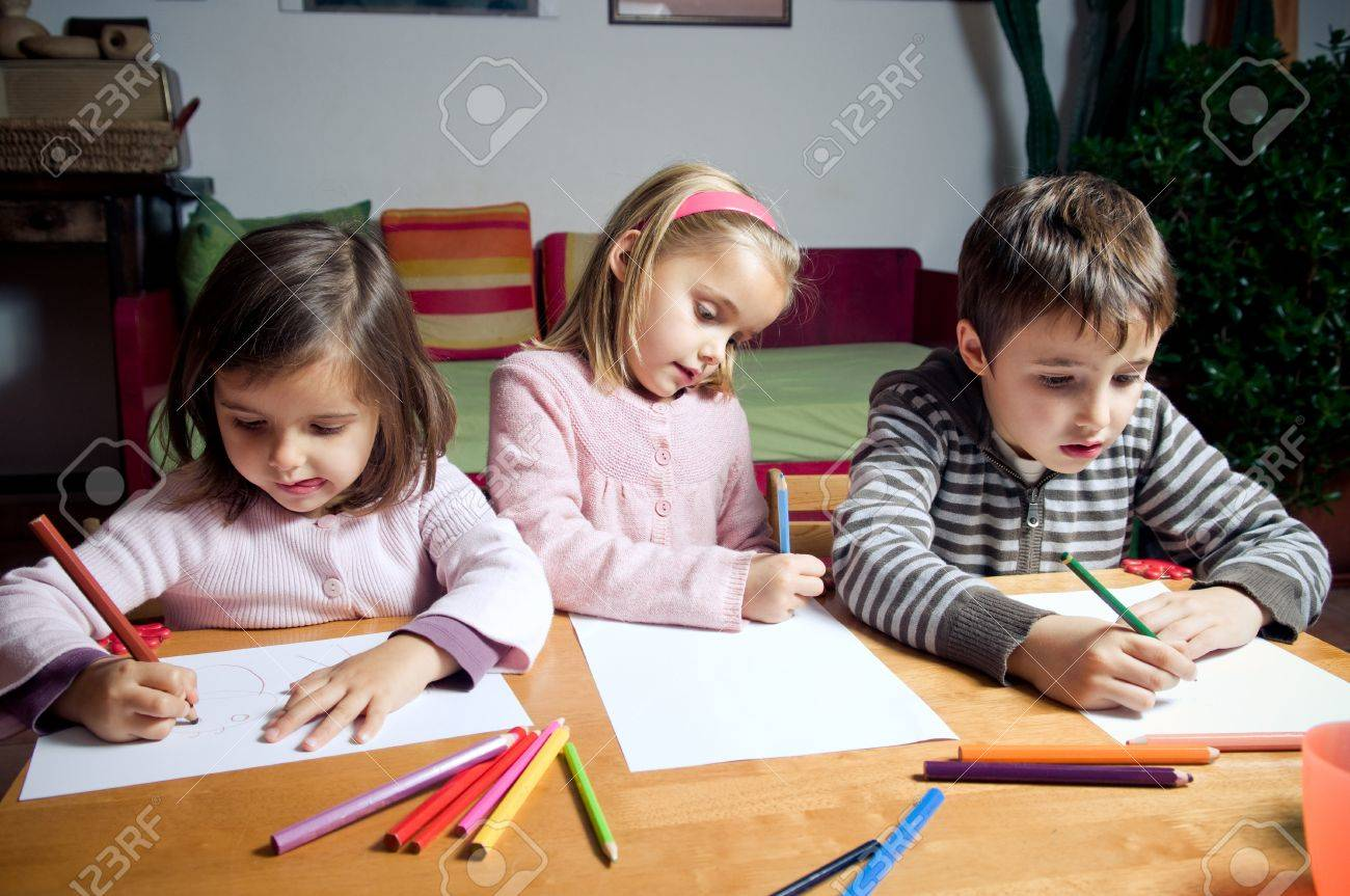 kids drawing with crayons stock photo picture and royalty free